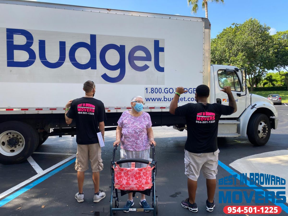 Best-in-Broward-Movers-worker-delivering-scaled