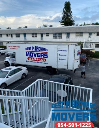 Best in Broward Movers truck and building